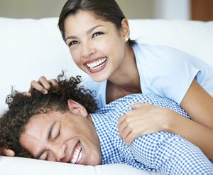 Image of young couple playfully hanging out