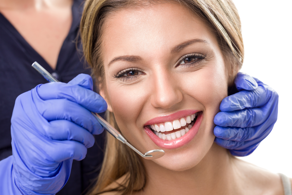 Patient receiving an implant dentistry consultation in Arcadia.