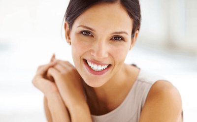 smiling girl other dental implants Dr. Peter S.Young