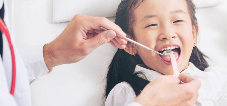Happy child who has overcome dental fear.