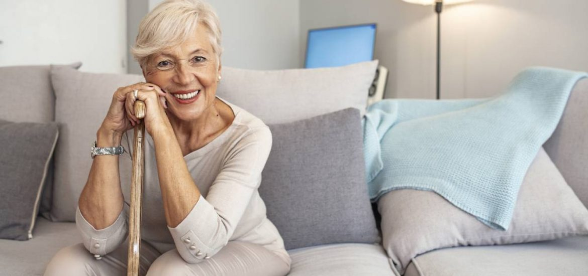 Woman smiling with dentures that are comfortable.